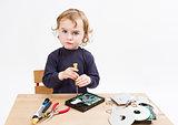 child repairing computer part