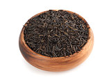 raw wild rice in wooden bowl