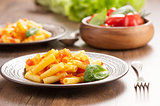 Penne pasta with tomatoes