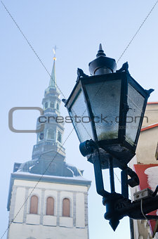 City street lantern on a background of church Niguliste