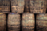 Stacked old whisky barrels