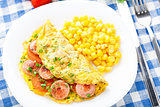 Omelet with sausage, tomato and herbs