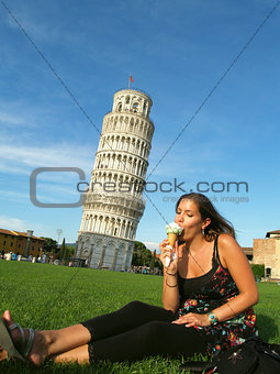 Beautiful girl in front of the tower of Pisa