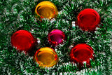 Christmas wreath of tinsel and balls as a texture