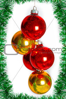 Christmas balls on a green tinsel as a symbol of the New year