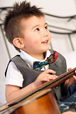 Happy Two Year Old Boy Interested in Arts and Music