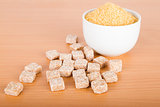 Brown cane sugar cubes and crystal sugar