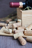 Wine corks on the table with bottle on the background
