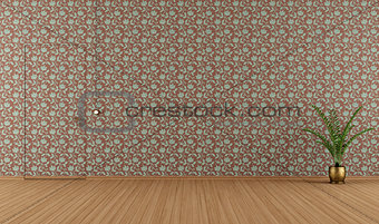 Empty room with vintage wallpape