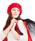Young Woman in Red Cap with Shopping Bags