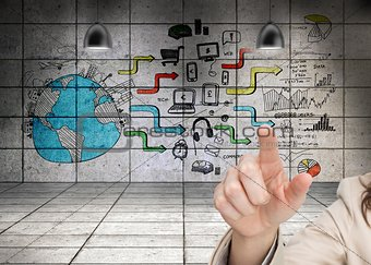Womans hand pointing against wall background showing global business development