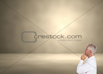 Thoughtful mature businessman posing