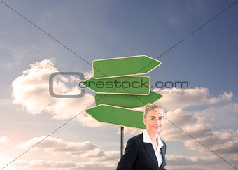 Blonde businesswoman smiling at camera