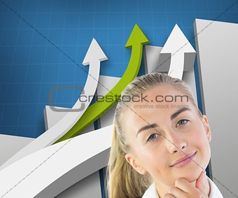Smiling blonde businesswoman looking at camera