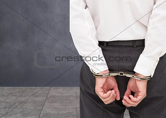 Close up on young businessman wearing handcuffs