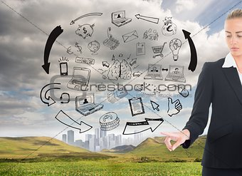 Blonde businesswoman pointing at illustrations