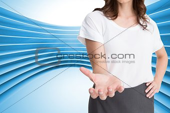 Attractive businesswoman showing her empty hand open
