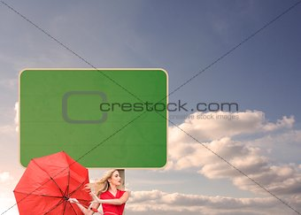 Beautiful woman posing with a broken umbrella