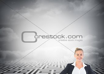 Blonde businesswoman standing with hands on hips