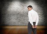 Serious businessman wearing handcuffs