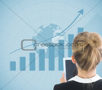 Blonde businesswoman holding tablet