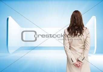 Rear view of businesswoman crossing hands behind back