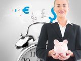 Blonde businesswoman holding piggy bank