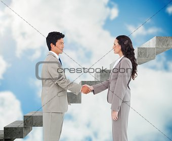 Side view of hand shaking trading partners