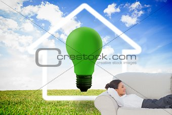 Smiling businesswoman lying down on the couch