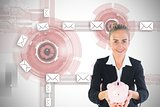 Blonde businesswoman holding pink piggy bank