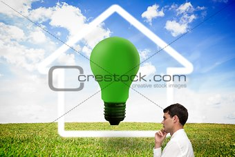 Thoughtful young businessman at house