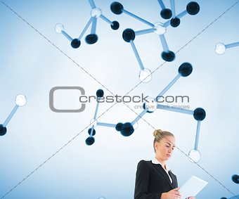 Blonde businesswoman holding new tablet