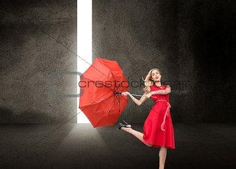Beautiful woman wearing red dress holding umbrella