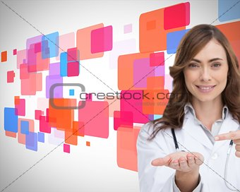 Smiling doctor pointing at something in her hand