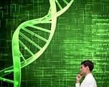 Thoughtful young businessman looking at dna spiral