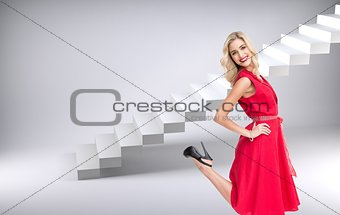 Blonde glamorous woman smiling at camera