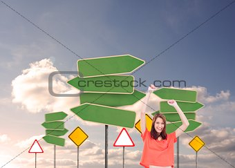 Cheerful woman with her arms raised up
