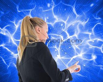 Blonde businesswoman pointing somewhere