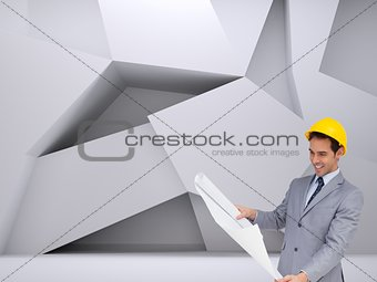 Smiling architect with hard hat looking at plans