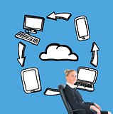 Businesswoman sitting in swivel chair in front of illustrations