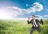 Joyful businessman holding a suitcase and running