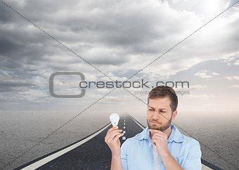 Skeptical model holding a bulb