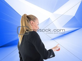 Blonde businesswoman pointing somewhere