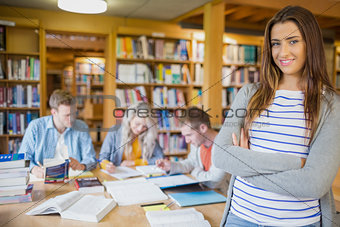 Female student with others in background at library