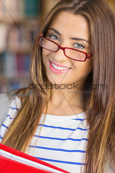 Close up of a smiling female student in library
