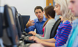 Teacher explaining to students in the computer room