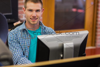 Male student using computer in the computer room