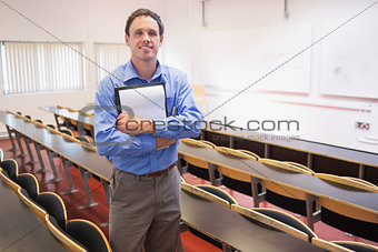 Male teacher with notepad in the lecture hall