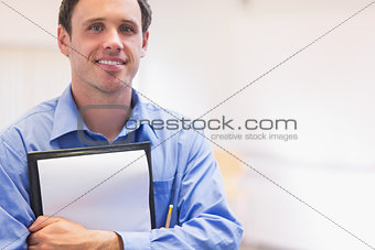 Close up portrait of an elegant male teacher with notepad