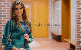 Beautiful smiling girl in college corridor